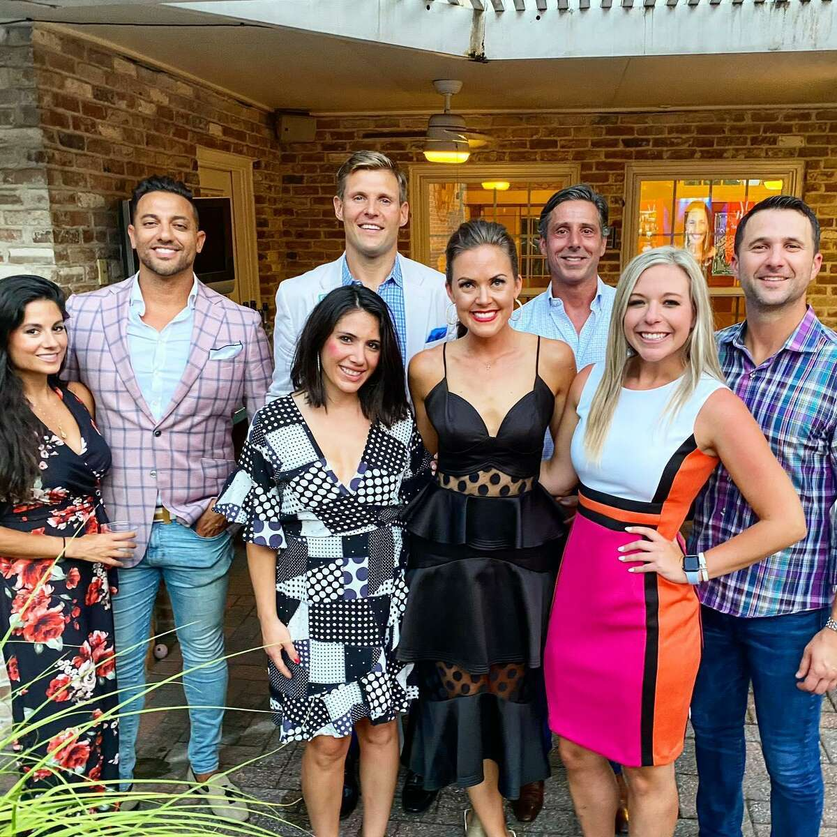 Leukemia & Lymphoma Society's Woman of the Year Lauren Paine, center front, celebrates her victory with friends and 2020 gala co-chair Scott Gildea, back row, second from right.