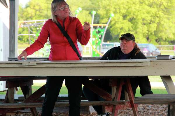 From left, Fork Township resident Sandra MacKersie and Chippewa Lake resident Sheri Fetterman spent Wednesday morning trying to inform residents on their reasonings behind circulating a petition to give residents the option to dissolve the Village of Barryton. Obtaining the needed number of signatures, the issue is now up for the voters to decide on Nov. 3. (Pioneer photo/Alicia Jaimes)