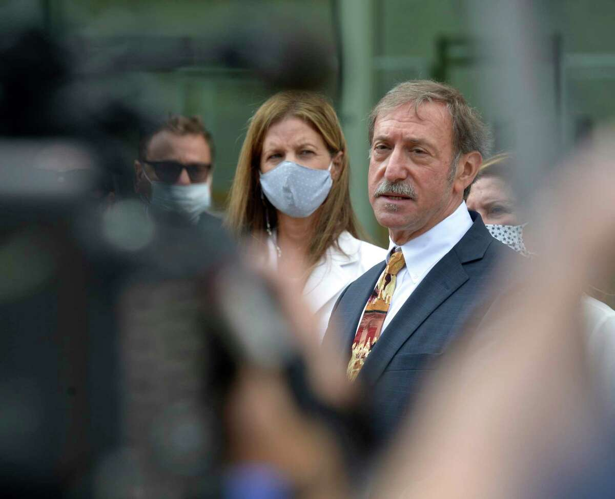 Attorney Jon Schoenhorn speaks to the media after representing Michelle Troconis, left, at state Superior Court in Stamford on Aug. 28.