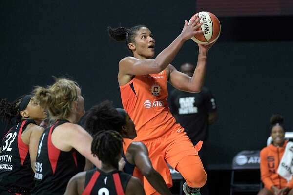 Connecticut Sun forward Alyssa Thomas goes up for a shot in front of the Las Vegas Aces' defense during Game 1 of their semifinal-round playoff game Sunday.