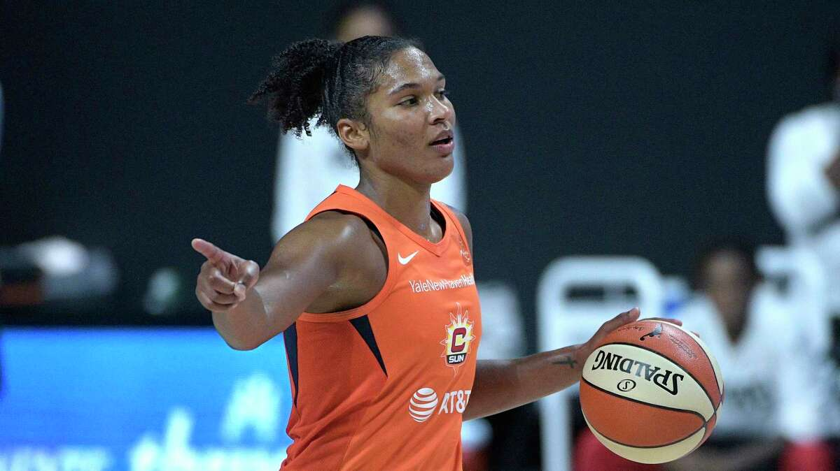 Connecticut Sun forward Alyssa Thomas brings the ball up the court against Las Vegas during Game 1 of their semifinal-round playoff game Sunday.