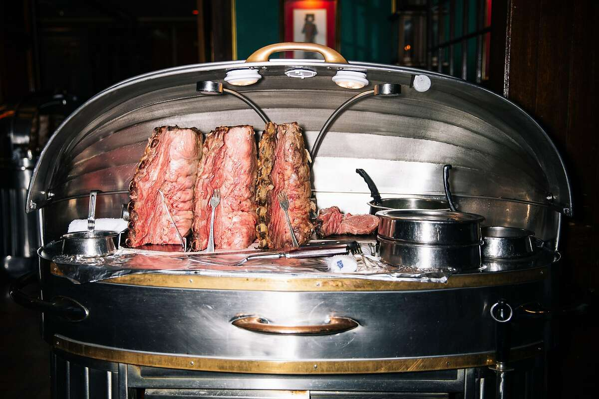 Racks of prime rib are seen in carver Caitlin Elliott's cart during dinner service at House of Prime Rib in San Francisco, Calif. on Thursday, Feb. 6, 2020. Elliott, a former pastry chef and single mother, is the first female carver at the Bay Area institution since its 1949 opening.