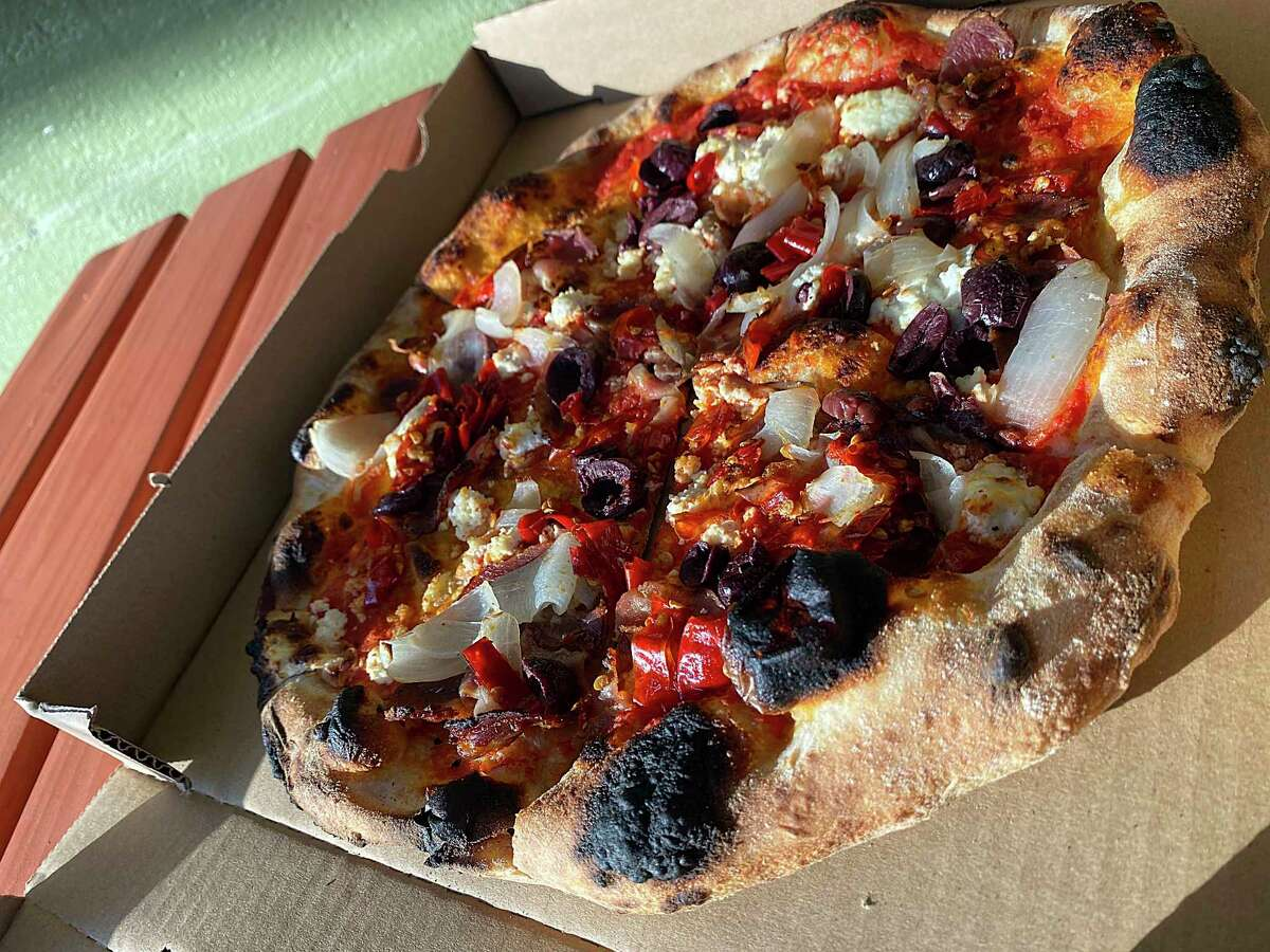 The Copa pizza incorporates sauce, ricotta cheese, capocollo, roasted onion, olives and Calabrese peppers at Il Forno, a San Antonio pizzeria from chef Michael Sohocki.