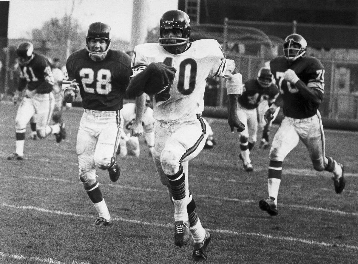 Hall of Fame running back Gale Sayers of the Chicago Bears left many defensive players in his wake.