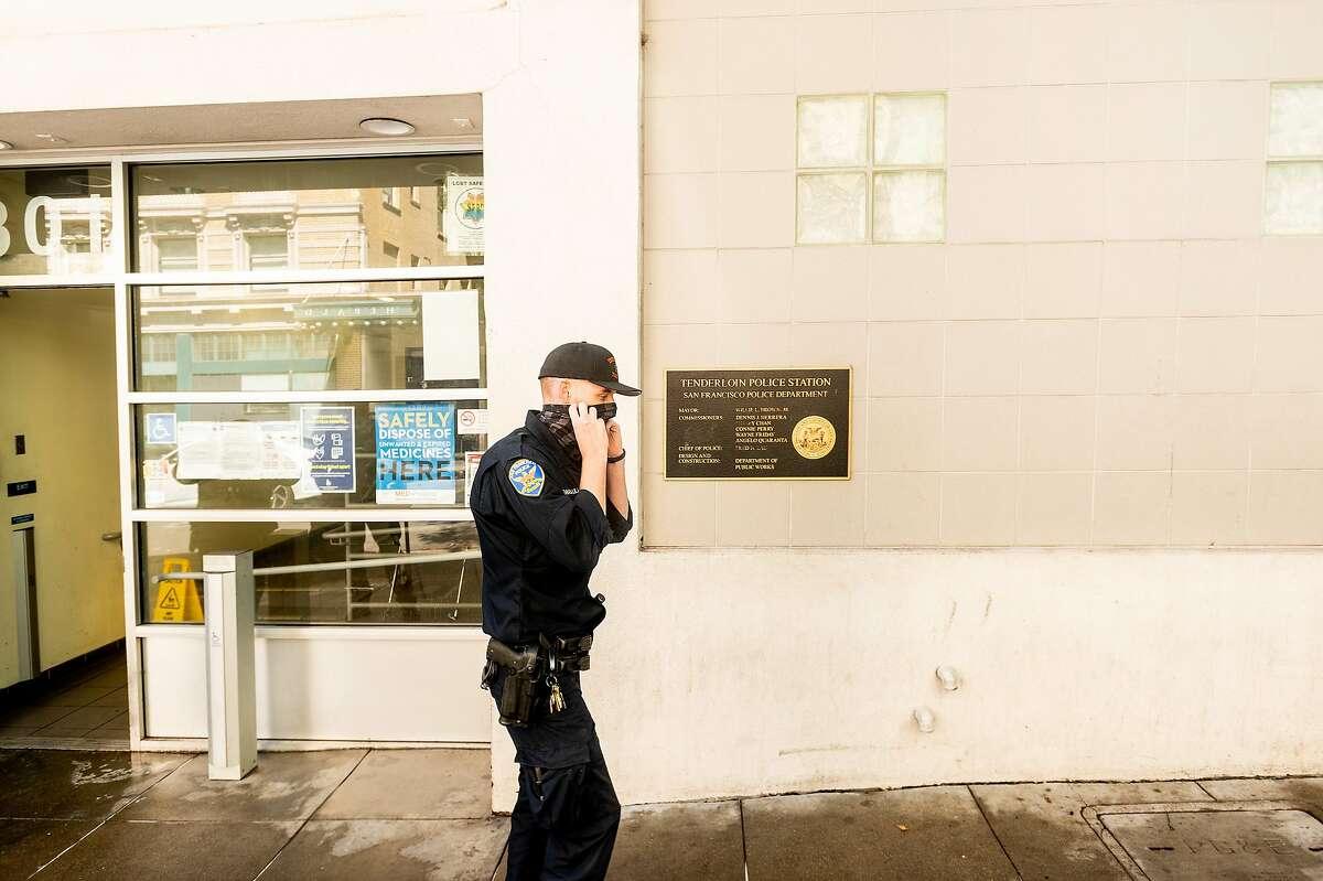 A police officer leaves the Tenderloin precinct on Wednesday, Sept. 23, 2020, in San Francisco.
