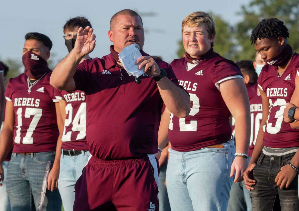 Lee High Coach Clint Hartman talks about the struggles his players have been going through 09/23/2020 with the proposed name change of the school, and said they will call themselves the Midland Lee Rebels for this school year during the Meet the Rebels night at Lee practice field. Tim Fischer/Reporter-Telegram