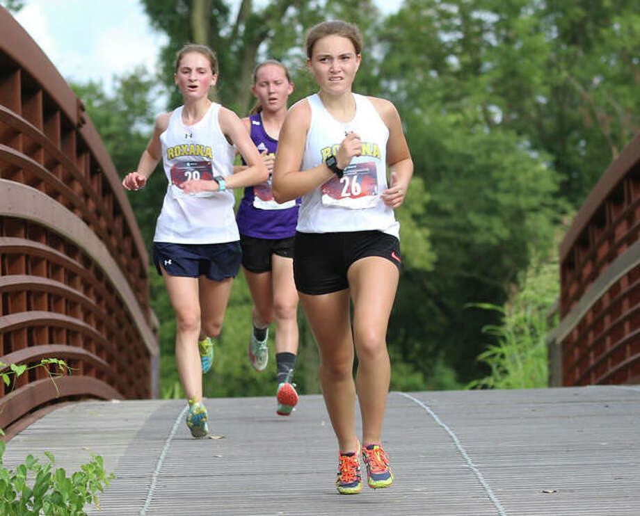 Roxana's Keiko Palen (right) and Gabrielle Woodruff (left) lead CM's Hannah Meiser over the bridge during a girls cross country meet Aug. 26 at the Bethalto Sports Complex. On Wednesday, the IHSA announced cross country and golf would Photo: Greg Shashack / The Telegraph