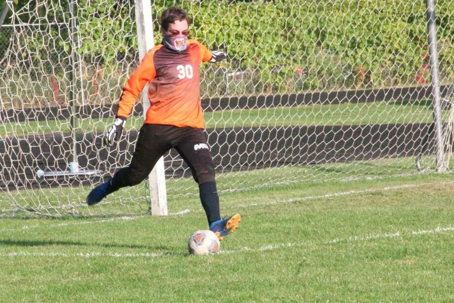 Crossroads goalkeeper Joey Gardei is set to give the ball a boot during Wednesday's home soccer game with Roscommon. (PIoneer photo/John Raffel)
