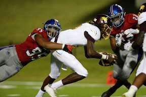 "West Brook's Jared Lane sacks Beaumont United quarterback Xzavier Vaughn during the ""Alumni Bowl"" at the Beaumont ISD Memorial Stadium on Friday night. Photo taken Friday 10/5/18 Ryan Pelham/The Enterprise"