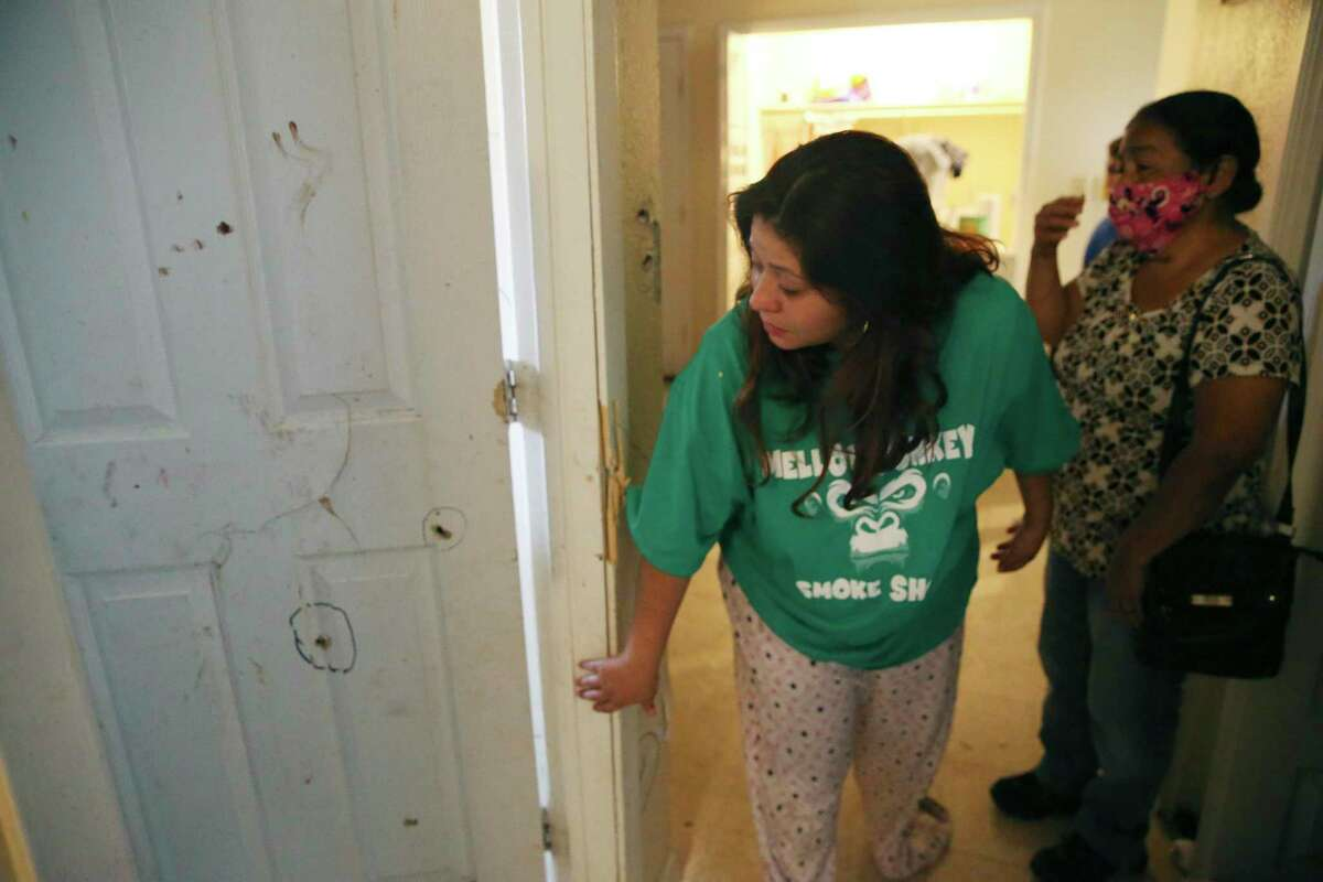 Angelic Barron, 28, reacts as she walks around her bullet-riddled apartment on the 5600 block of Culebra Road on Wednesday, Sept. 23, 2020. The father of her 1-year-old child, Victor Sanchez, 44, was shot and killed by San Antonio police officers after they said he pointed a gun at them. Sanchez' mother, Rose Sanchez, 66, is on the right.