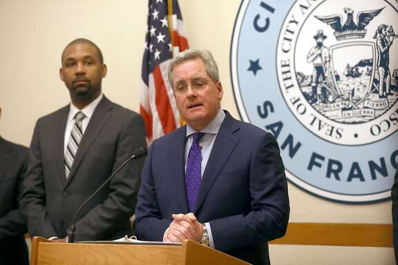 City Attorney Dennis Herrera, right, shown with Supervisor Shamann Walton, has announced a plan to keep 28 suspected drug dealers out of the Tenderloin.