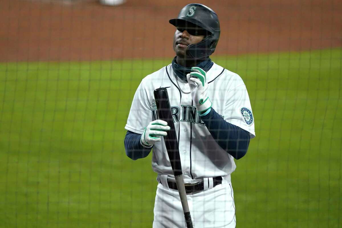 Seattle Mariners' Kyle Lewis holds his bat as he stands on the on-deck circle during the second inning of a baseball game against the Houston Astros, Wednesday, Sept. 23, 2020, in Seattle. (AP Photo/Ted S. Warren)