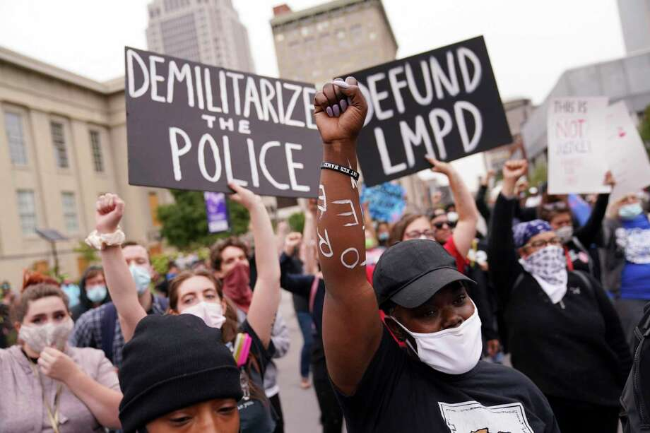 Protesters speak Wednesday in Louisville, Ky. A grand jury has indicted one officer on criminal charges six months after Breonna Taylor was fatally shot by police in Kentucky. Photo: John Minchillo / Associated Press / Copyright 2020 The Associated Press. All rights reserved