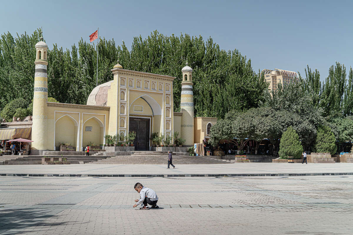 The Chinese flag hoisted above the famous Idkah mosque in Kashgar stands taller than the crescents and minarets, a way to show which institution is pre-eminent.