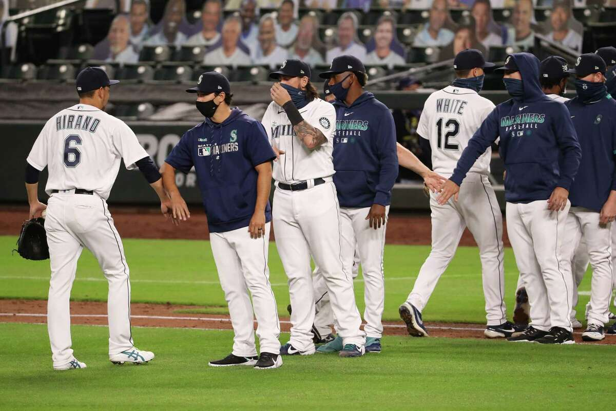 SEATTLE, WASHINGTON - SEPTEMBER 23: Yoshihisa Hirano #6 of the Seattle Mariners celebrates with teammates after recording a save to defeat the Houston Astros 3-2 at T-Mobile Park on September 23, 2020 in Seattle, Washington.
