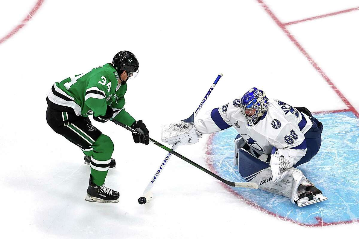 EDMONTON, ALBERTA - SEPTEMBER 23: Andrei Vasilevskiy #88 of the Tampa Bay Lightning makes the save against Denis Gurianov #34 of the Dallas Stars during the first period in Game Three of the 2020 NHL Stanley Cup Final at Rogers Place on September 23, 2020 in Edmonton, Alberta, Canada. (Photo by Bruce Bennett/Getty Images)