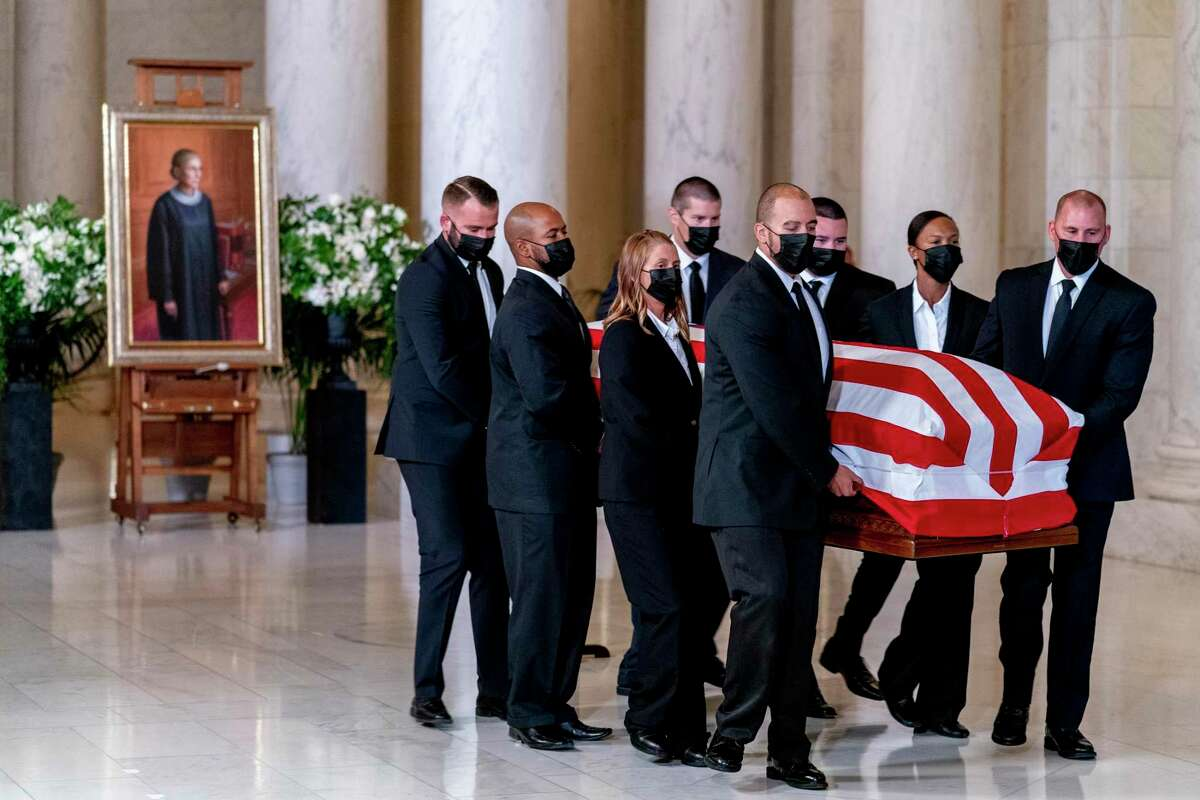 The flag-draped casket of Justice Ruth Bader Ginsburg arrives at the Supreme Court in Washington, Wednesday, Sept. 23, 2020. (Andrew Harnik/Pool via The New York Times) -- FOR EDITORIAL USE ONLY --