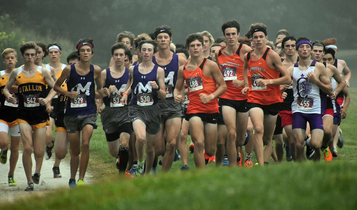 A pack of runners move up the hill shortly after the start of the Belleville West Invitational earlier this month.