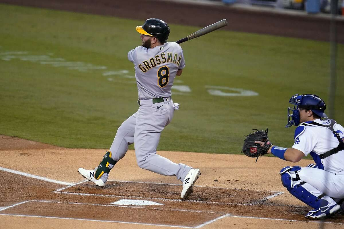 Oakland Athletics' Robbie Grossman follows through on an RBI double during the first inning of the team's baseball game against the Los Angeles Dodgers on Wednesday, Sept. 23, 2020, in Los Angeles. (AP Photo/Marcio Jose Sanchez)
