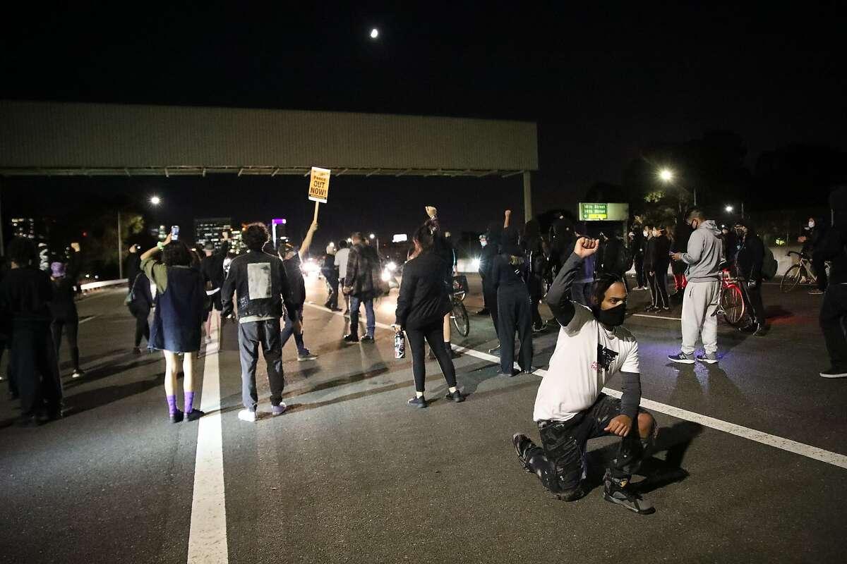 Paris Browder, 28, of San Jose, pumps his fist while protestors chant