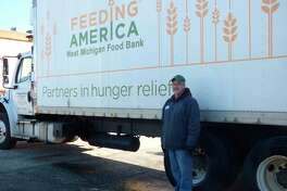Feeding America driver Jerry Grooten delivered food to the Manistee Friendship Society food pantry earlier this year. (File photo)