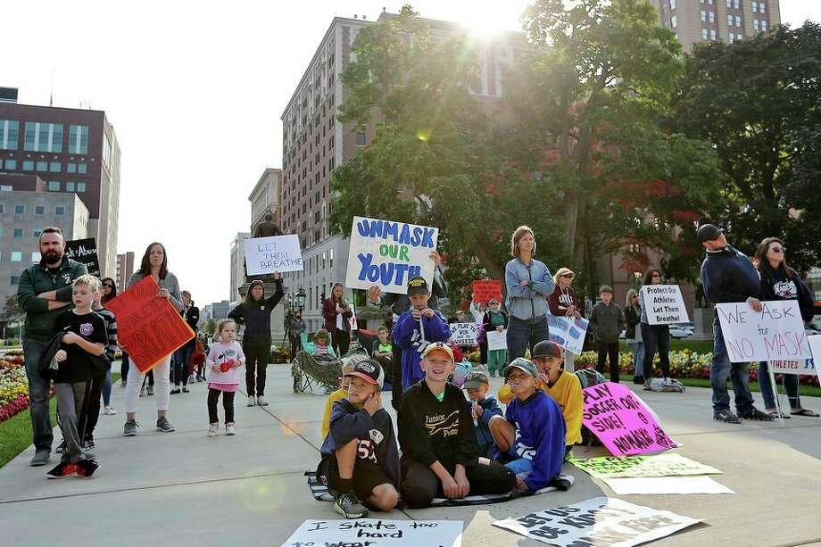 Protesters rally to unmask youth athletes Wednesday outside the Michigan Capitol Building in Lansing. (Mike Mulholland/MLive.com via TNS) / mlive.com