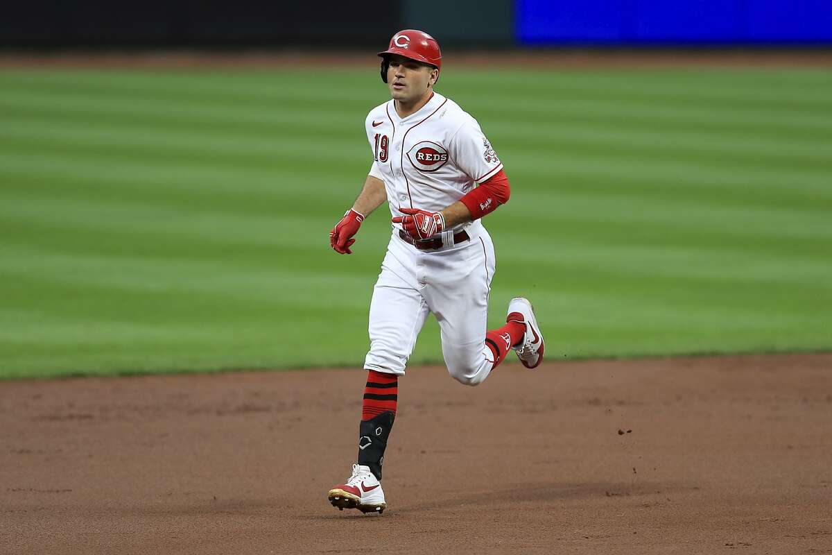 Cincinnati Reds' Joey Votto runs the bases after hitting a two-run home run during a baseball game against the Milwaukee Brewers in Cincinnati, Wednesday, Sept. 23, 2020. The Reds won 6-1. (AP Photo/Aaron Doster)