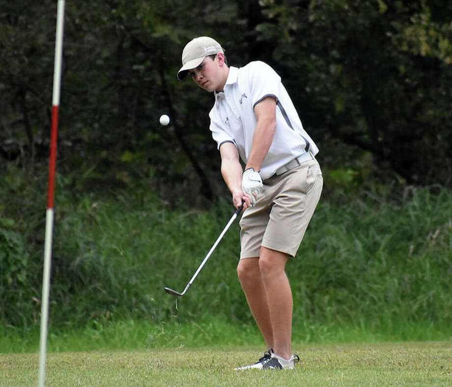 Father McGivney's Joey Hyten chips his shot onto the green on No. 14 at Oak Brook Golf Club during a triangular match with Metro-East Lutheran and Valmeyer on Wednesday. Photo: Matt Kamp|The Intelligencer