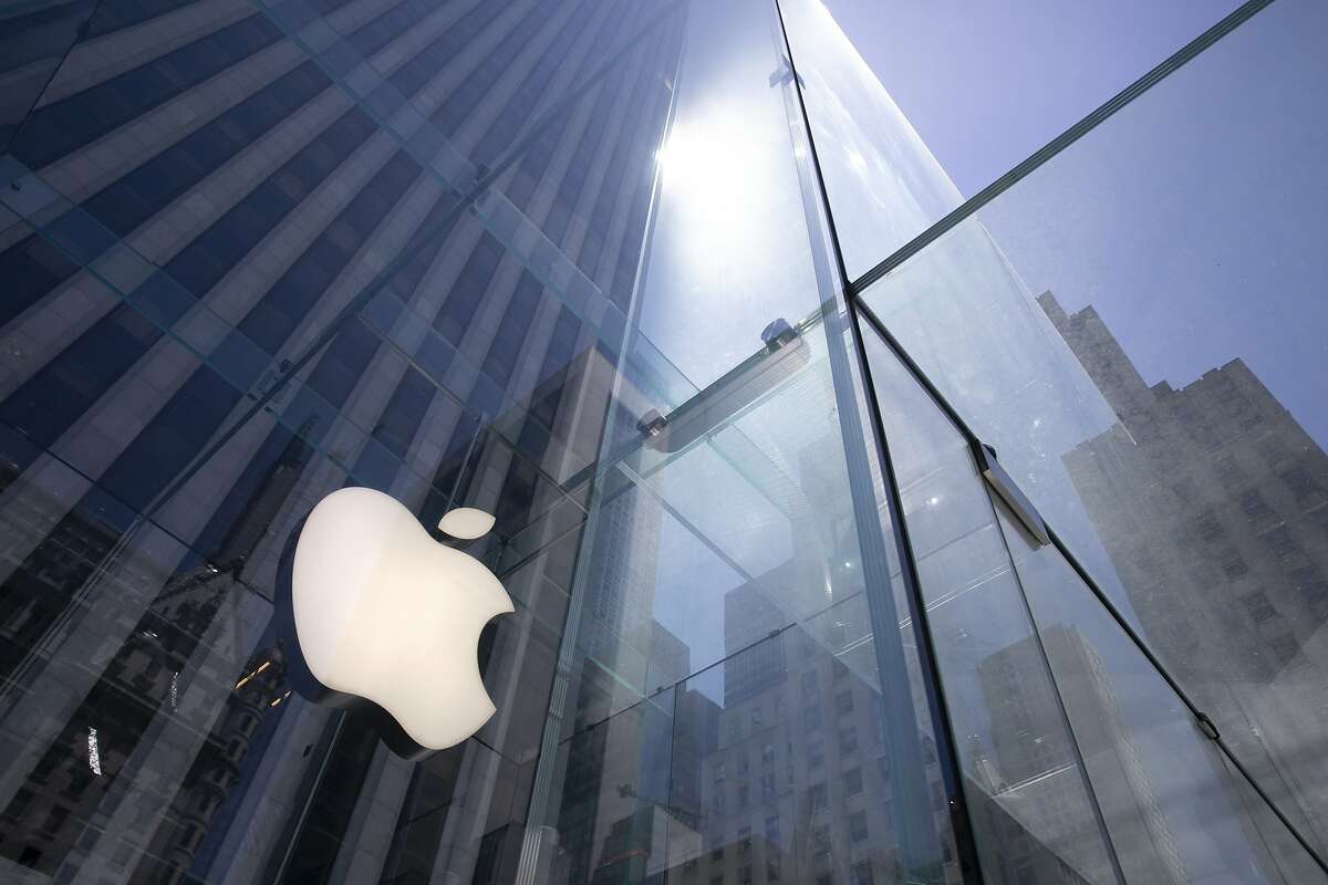 In this June 16, 2020, file photo, the sun is reflected on Apple's Fifth Avenue store in New York.