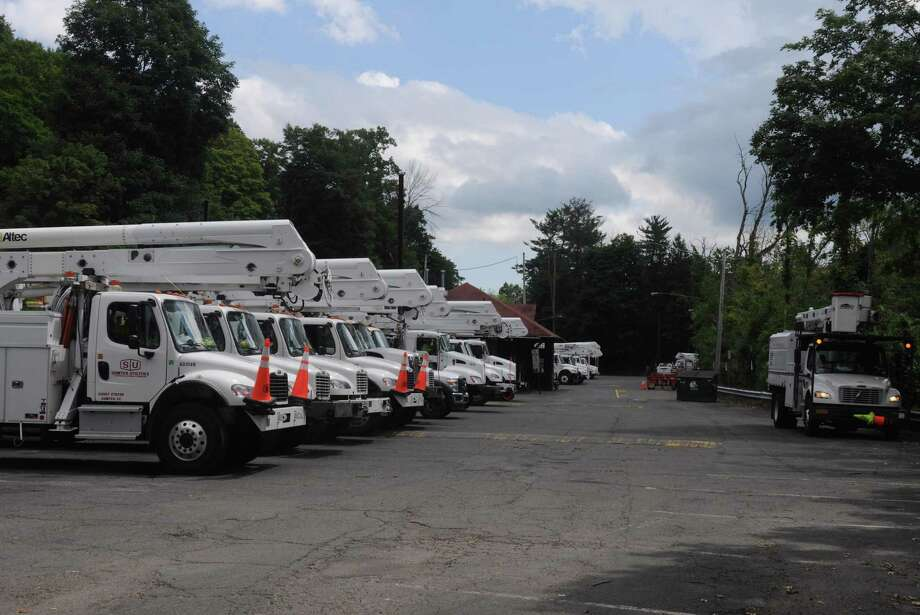 Utility trucks parked at Branchville Station Aug. 9, six days after Storm Isaias, awaiting instructions on how to help. A new ruling from the state calls for more cooperation between the utilities and town authorities. Photo: Macklin Reid / Hearst Connecticut Media