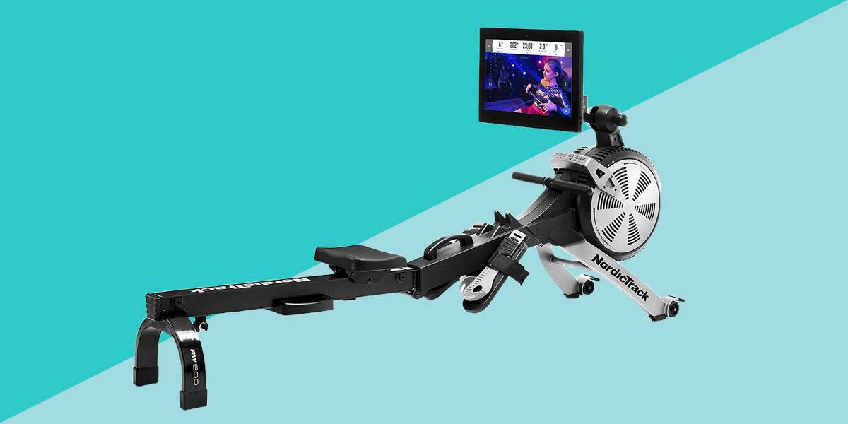 """Why are at-home rowing machines so popular right now? Because they offer a full-body workout in one compact piece of equipment. Just ask Nick Karwoski, a Hydrow athlete and triathlete. """"Using a rowing machine is one of the most efficient ways to get a cardiovascular and strength training workout in a short amount of time,"""" he says. """"You can easily get a total-body workout in 20 minutes."""" What is a rowing machine, exactly? A rowing machines mimics what it feels like to row a boat, so you get the same resistance of water on a machine, increasing your heart rate and building strength. What also makes rowing more appealing to those who dislike running and other high-impact exercises like HIIT, is that it's a low-impact workout that goes easy on your joints. While rowing might appear to be mostly an upper-body workout, your legs and glutes are actually the main muscles driving your stroke. """"Rowing is 80% legs and 20% upper body,"""" Karwoski says. """"But it also forces you to engage your core and back, so you feel completely connected from your feet to your shoulders. We live in an ever-stressed world, where we're constantly sitting and rounding our backs, but rowing helps correct this by engaging those lats and sitting upright."""" How to use a rowing machine Before you hop on a rowing machine, keep these form tips in mind. In rowing,..."""