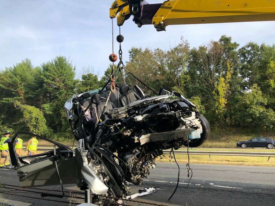 A Chevrolet sedan is lifted out of a wooded area off the shoulder of eastbound I-84 near Exit 8 the morning of Sept. 24, 2020. Photo: Stony Hill Volunteer Fire Company