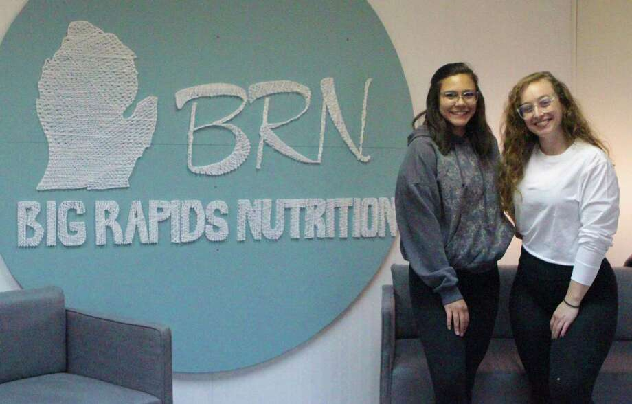 Sierra Lopez and Erica Hansen, owners of Big Rapids Nutrition, said they love operating the business and getting to know the community. (Pioneer photo/Taylor Fussman)