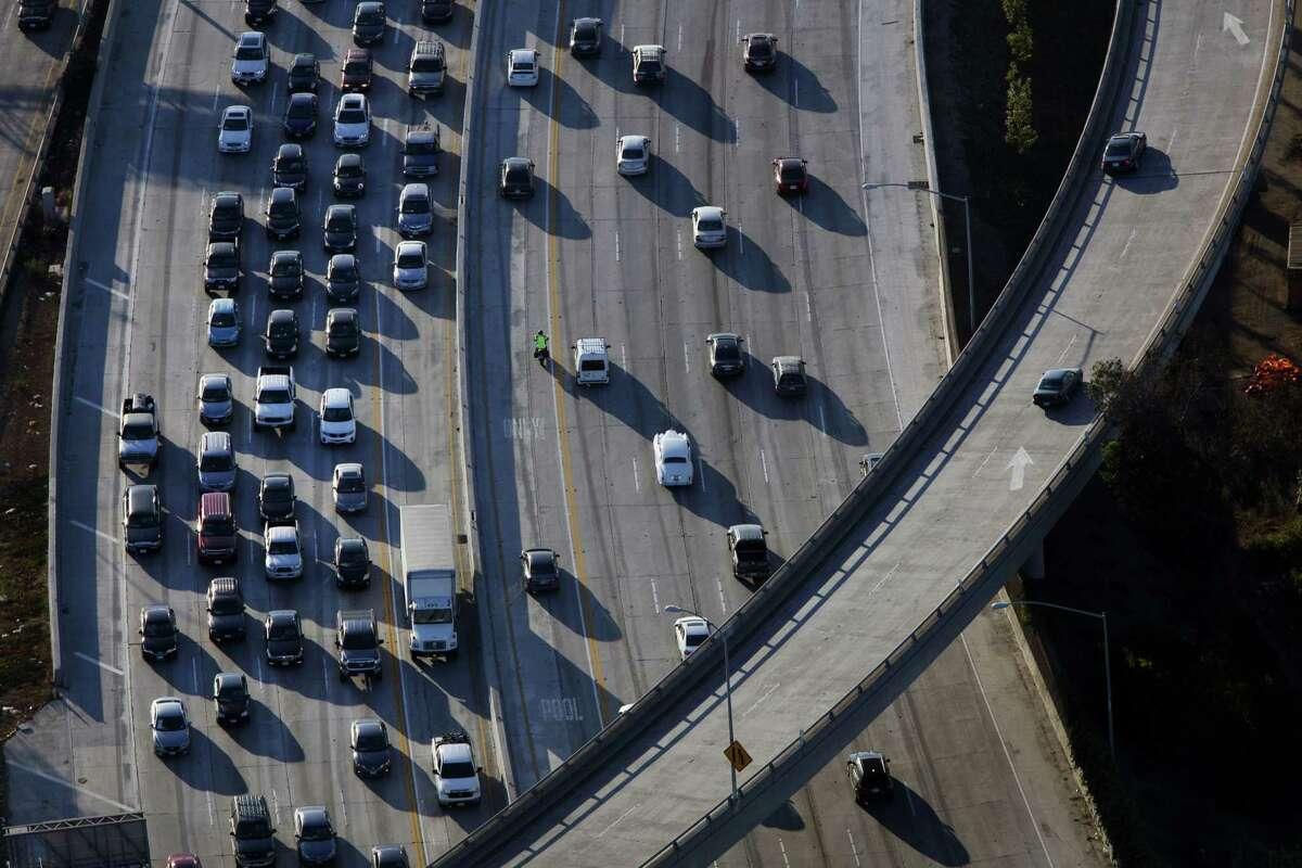 Vehicles sit in rush-hour traffic at the interchange between the Interstate 405 and 10 freeways in this aerial photograph taken over Los Angeles.