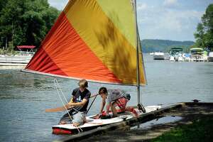 Dan Reilly, 18, left, and Justin Halmose, 17, of Newtown, prepare to launch their sunfish from Lattins Cove in Danbury for a sail on Candlewood Lake Thursday, August 9, 2018.