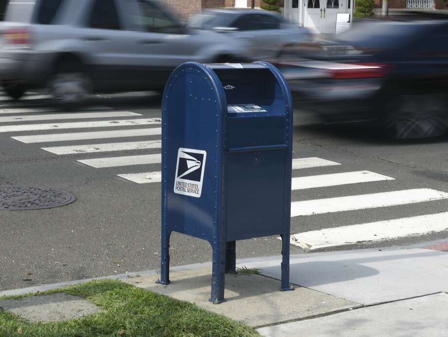 A Cars pass by a USPS mailbox along the Post Road in central Greenwich, Conn. Monday, Aug. 17, 2020. Photo: Tyler Sizemore, Hearst Connecticut Media