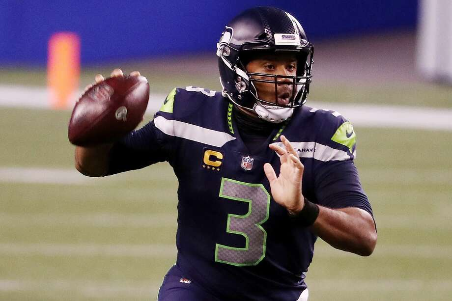 SEATTLE, WASHINGTON - SEPTEMBER 20: Russell Wilson #3 of the Seattle Seahawks looks to pass during the second half against the New England Patriots at CenturyLink Field on September 20, 2020 in Seattle, Washington. (Photo by Abbie Parr/Getty Images) Photo: Abbie Parr/Getty Images / 2020 Getty Images