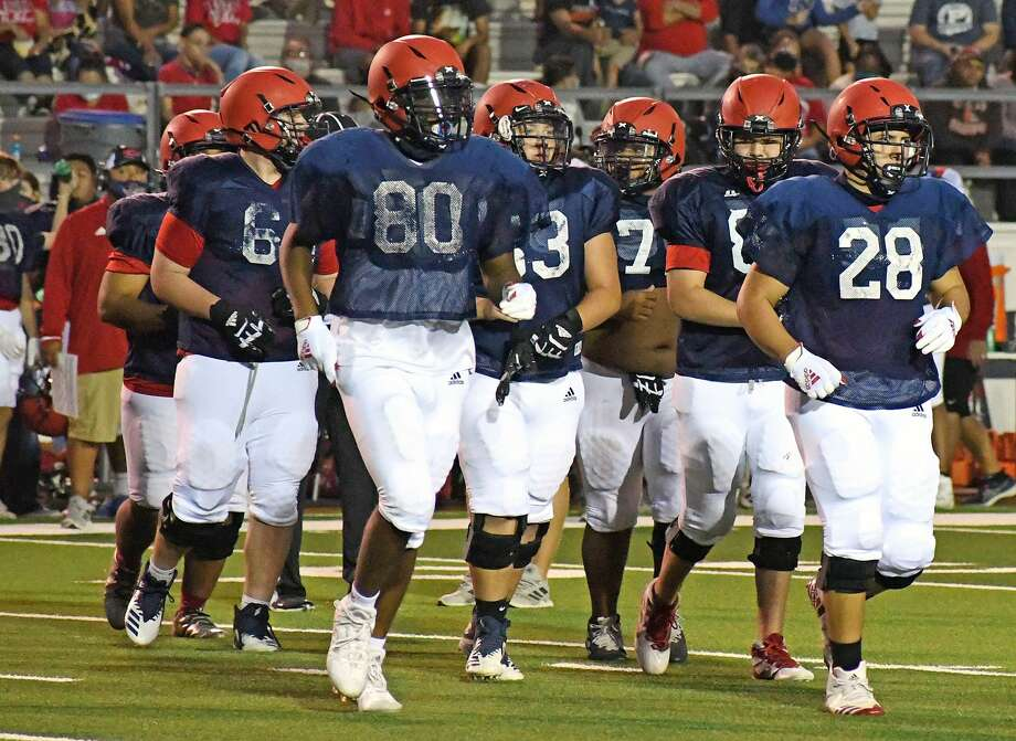 The offense trots onto the field for the Plainview football team during a scrimmage against Lubbock Coronado on Sept. 18, 2020 in Greg Sherwood Memorial Bulldog Stadium. The Bulldogs will open on season tonight at Hereford. Photo: Nathan Giese/Planview Herald