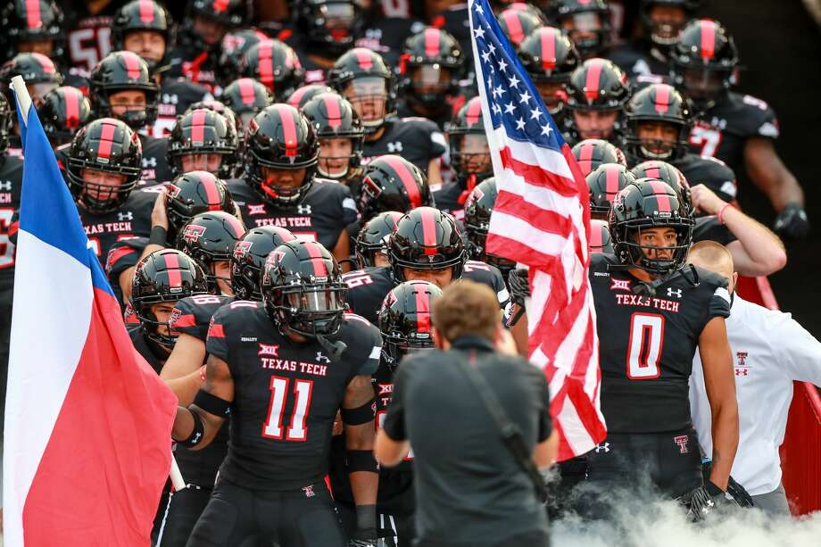 LUBBOCK, TEXAS - SEPTEMBER 12: Players for the Texas Tech Red Raiders including defensive back Eric Monroe #11 and receiver Seth Collins #1 prepare to take the field before the college football game against the Houston Baptist Huskies on September 12, 2020 at Jones AT&T Stadium in Lubbock, Texas. (Photo by John E. Moore III/Getty Images) Photo: John E. Moore III/Getty Images / 2020 Getty Images