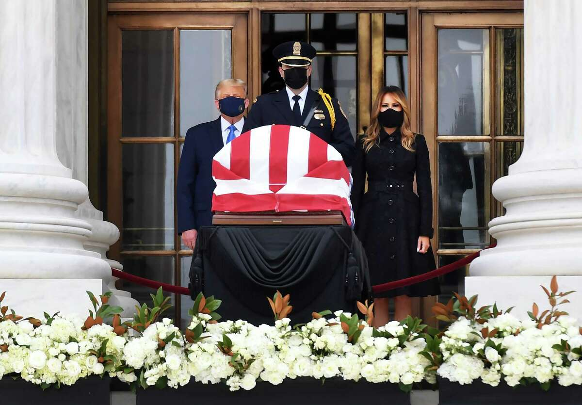 President Trump and First Lady Melania Trump pay their respects to Ruth Bader Ginsburg at the Supreme Court on Thursday.