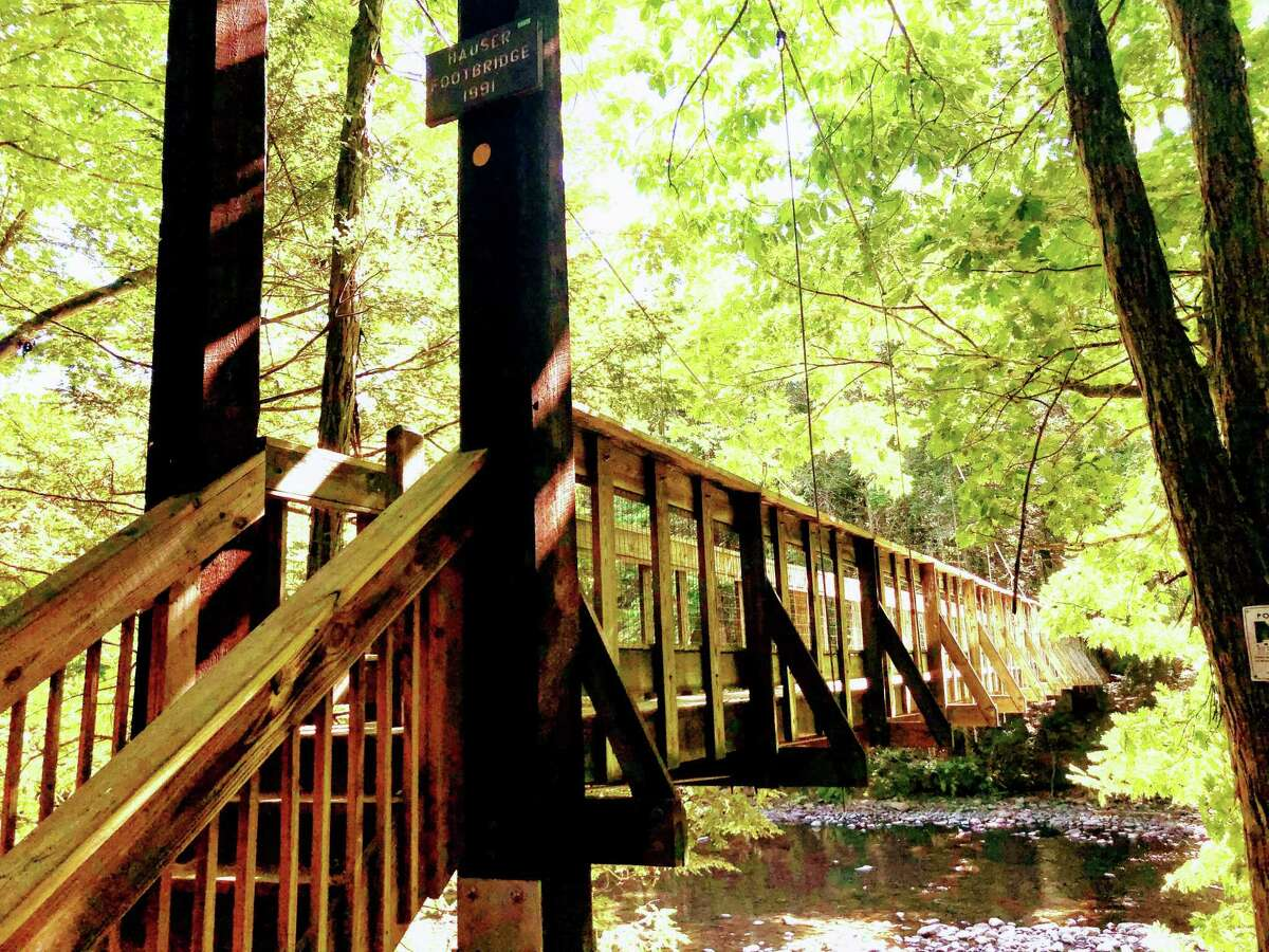 The Hauser Footbridge at Steep Rock Preserve in Washington Depot. We headed south to the Steep Rock Preserve, a 998-acre destination with lovely and mostly level hiking trails following the Shepaug River bank and also steeper trails to hillsides above offering nice views. There's a former rail tunnel through rock and a pedestrian bridge over the river among the hiking loops that range from under a mile to four miles.
