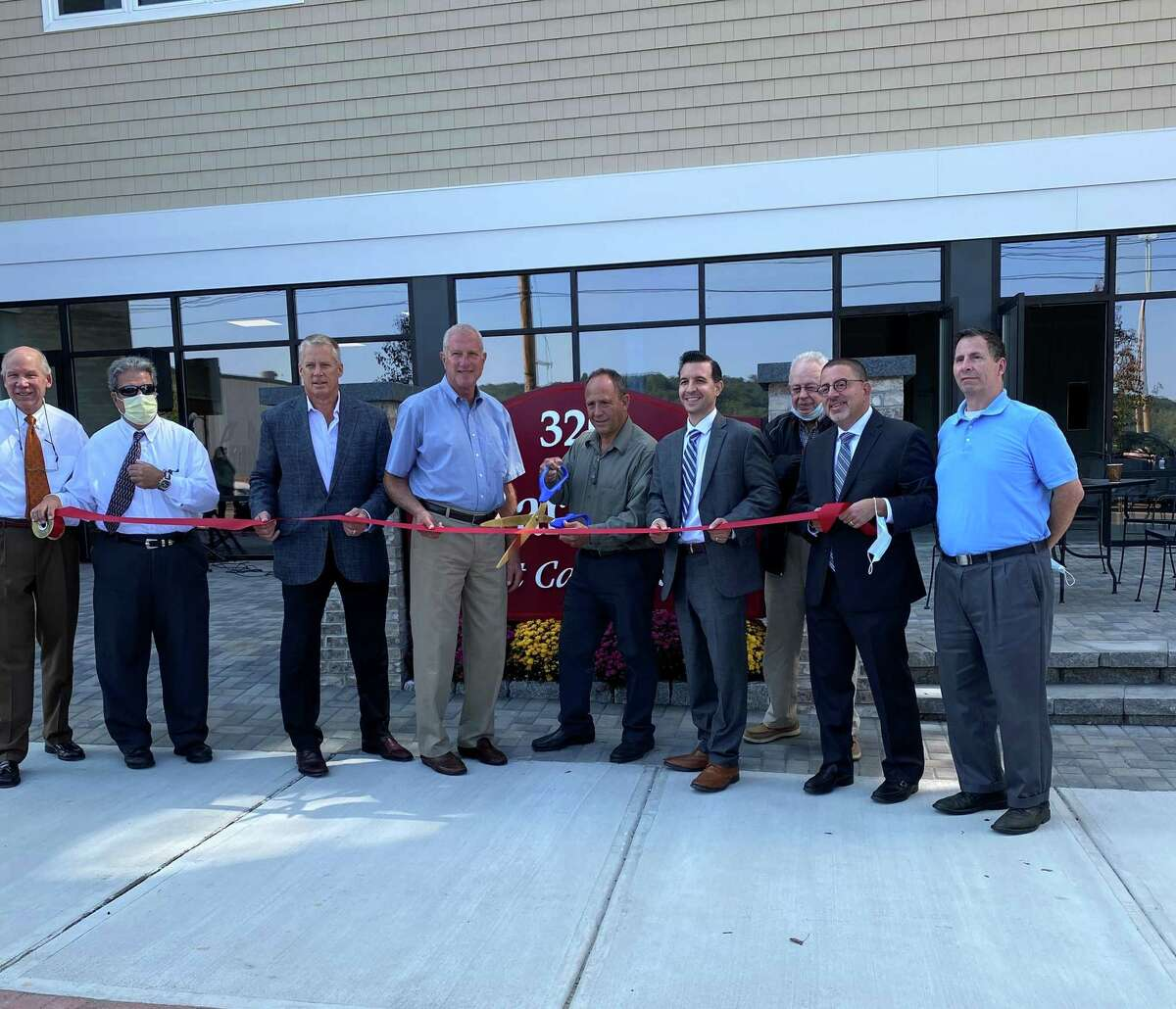 Developer Don Stanziale was joined by Mayor Mark Lauretti and members of the Board of Aldermen and Greater Valley Chamber of Commerce on Wednesday, Sept. 23, in celebrating the grand opening of Cedar Village at Carroll's on Howe Avenue.