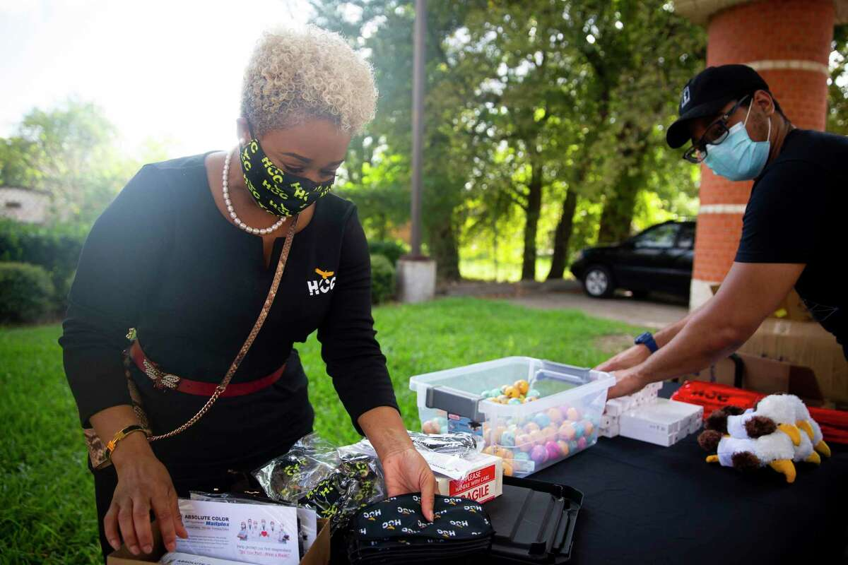 Dr. Shantay Grays, vice chancellor of student services at Houston Community College, organizes the Third Ward giveaway.