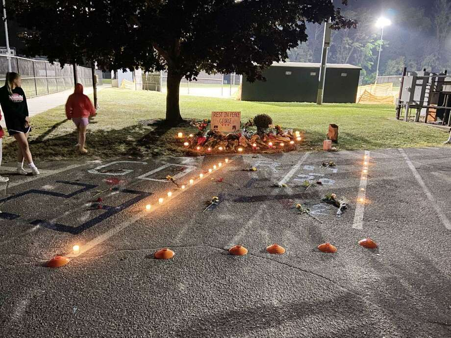 A memorial was set up in the junior lot at Wilton High School to honor the memory of George DiRocco, who passed on Sept. 21, 2020. Photo: Jake Sommer Photo