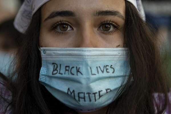 Former San Antonio charter school teacher Lillian White said despite losing her job, she stands by her decision to use her facial coverings to support the Black Lives Matter Movement. (Photo by Pablo Blazquez Dominguez/Getty Images)