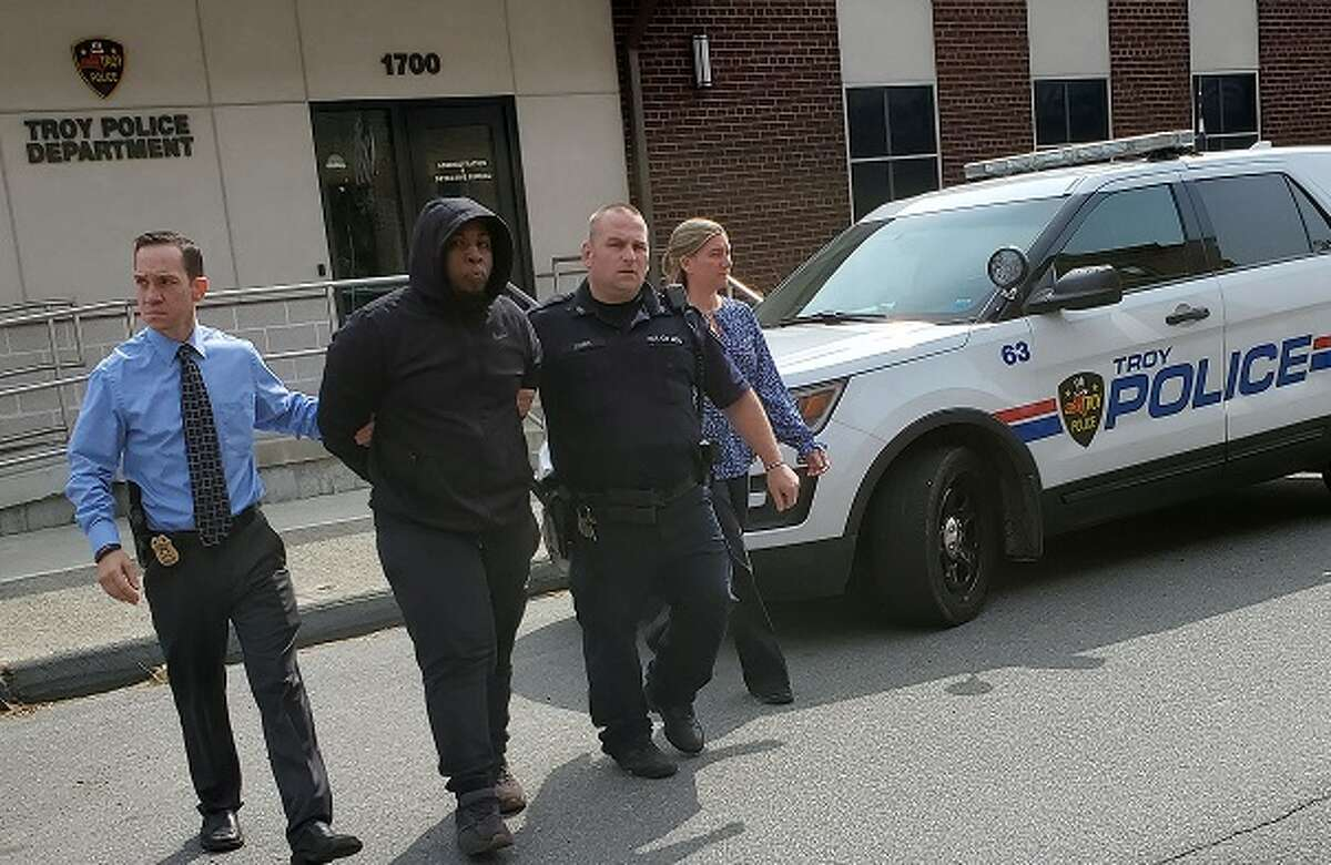 Troy police detective and patrol officer lead Jahquay E. Brown from the detective bureau to arraignment in Troy City Court Thursday, Sept. 24, 2020.Troy police detective and patrol officer lead Jahquay E. Brown from the detective bureau to arraignment in Troy City Court Thursday, Sept. 24, 2020.