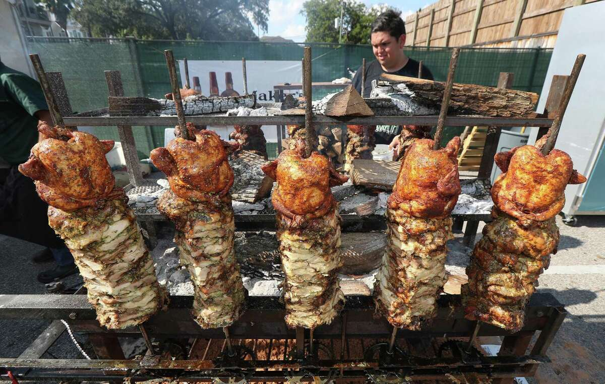 Vincent Huynh bastes chef Marcelo Garcia's chicken during last year's Southern Smoke festival.