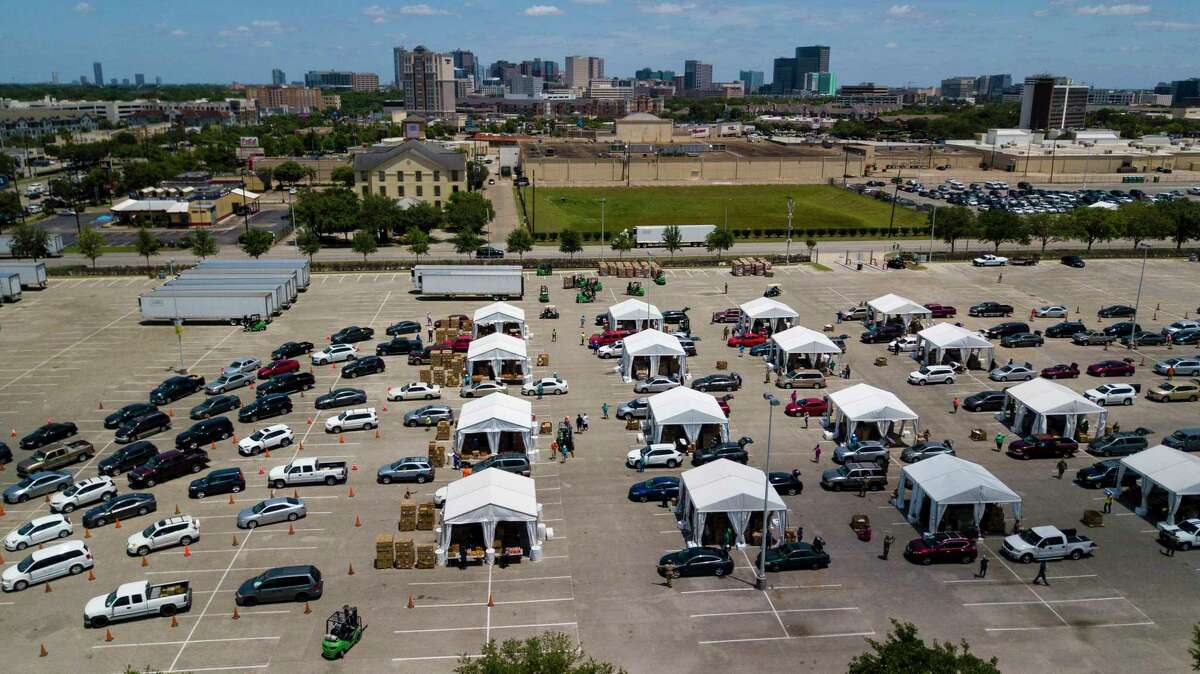 Aerial view of a community food distribution day in May at NRG Park organized by the Houston Food Bank and HISD.