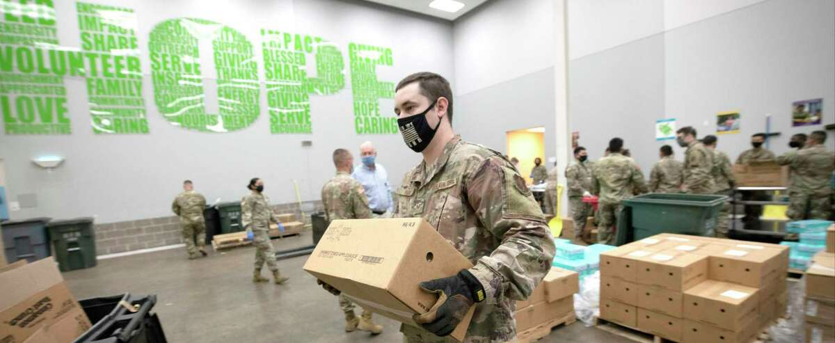 The National Guard helped organize, pack and transport food at the Houston Food Bank during the coronavirus pandemic.