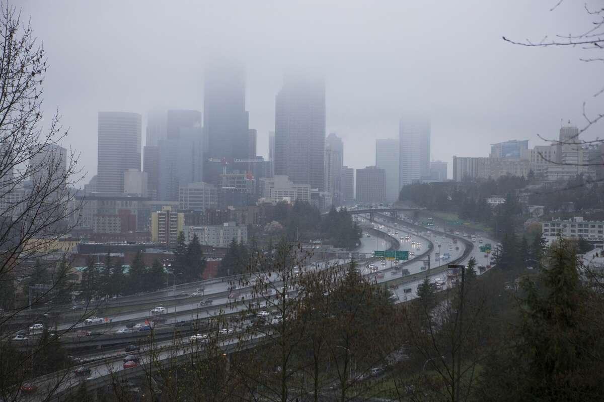 Seattle skyline under stormy skies.